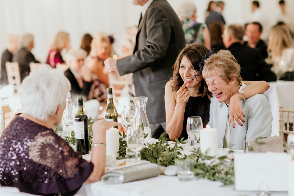 guests laugh with grandmas during a Poulton wedding