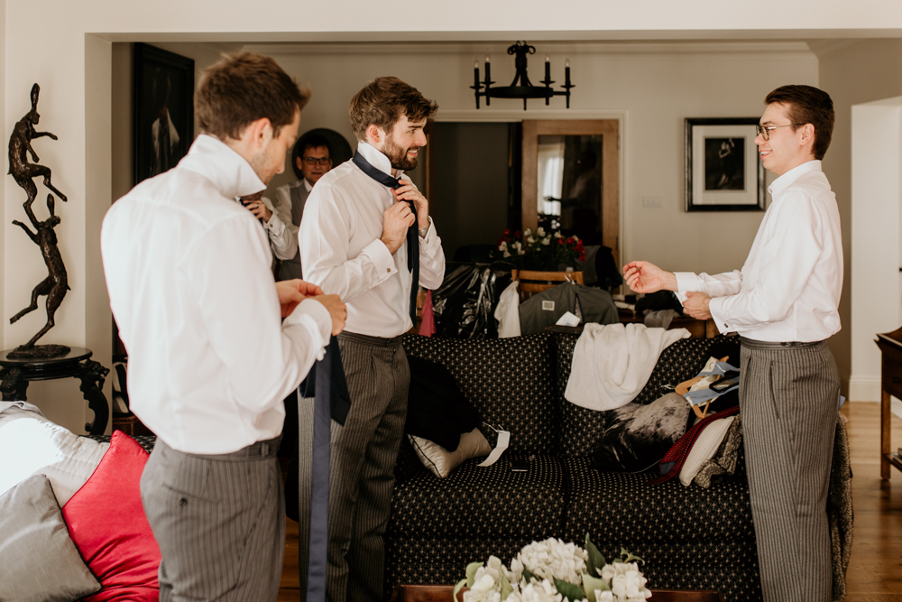 groomsmen getting ready in the morning for a Poulton wedding