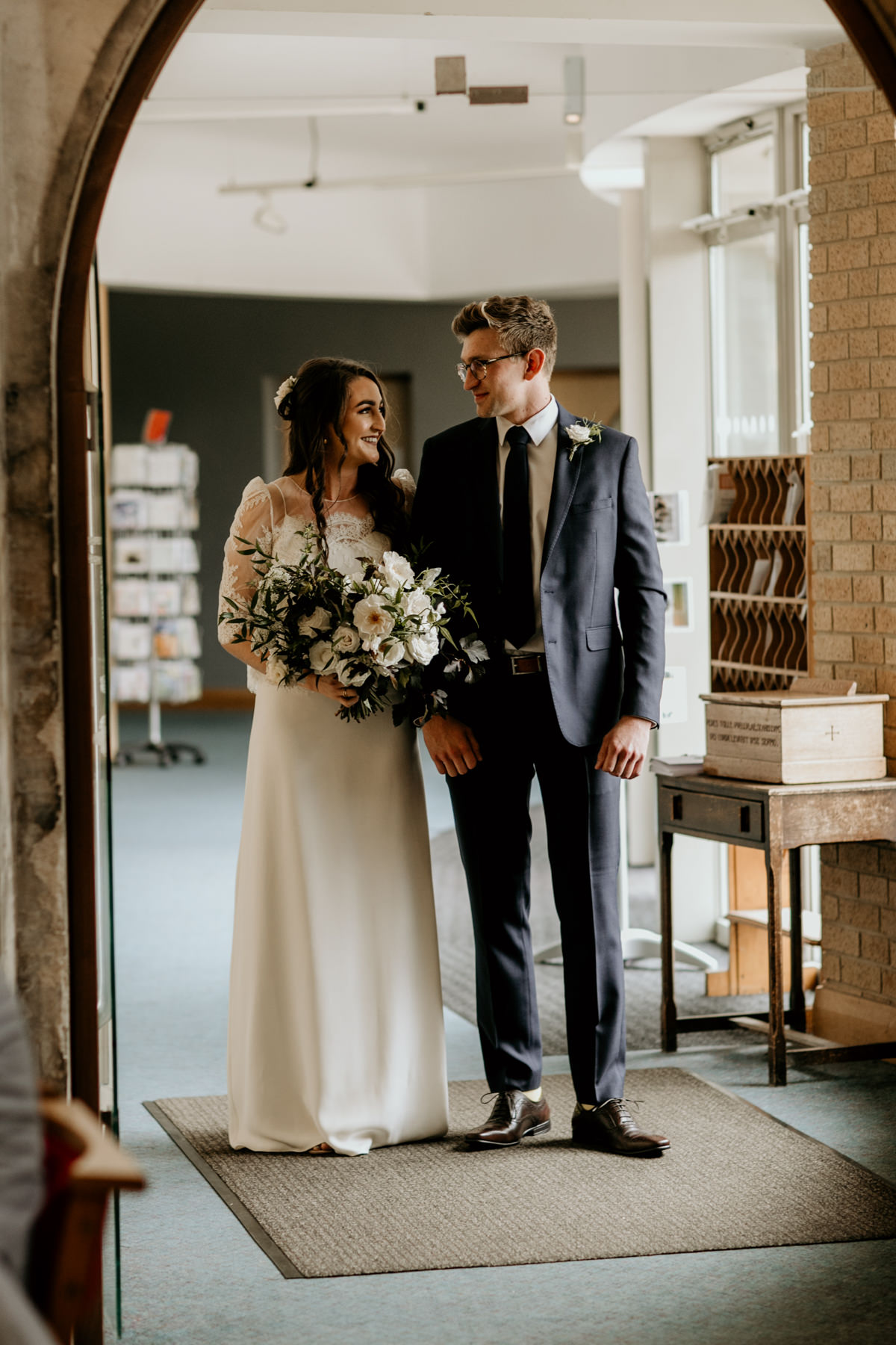 bride and brother walking down the aisle for her church wedding ceremony