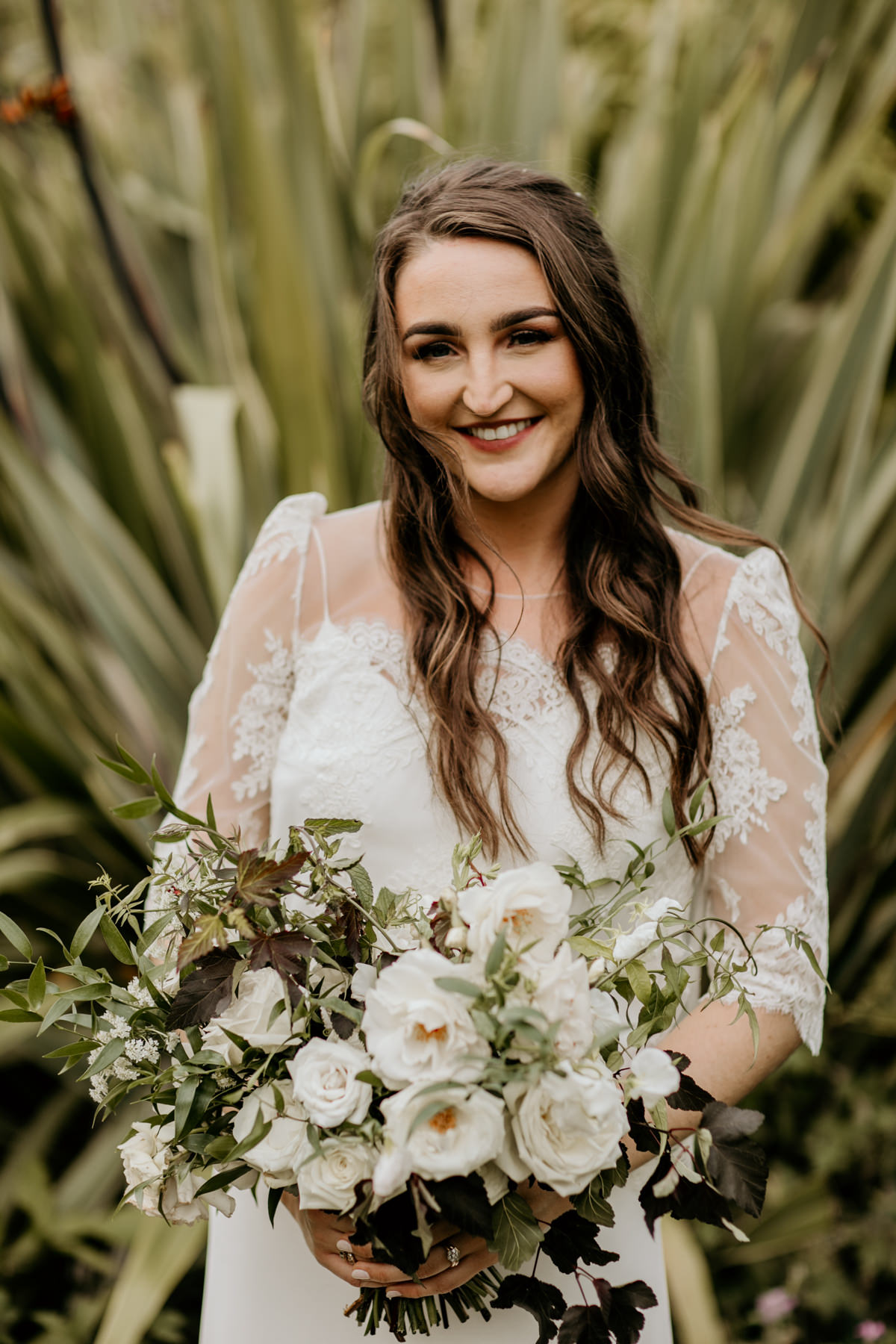 bride portraits with white and green flowers by Gloucesterhire wedding photographer