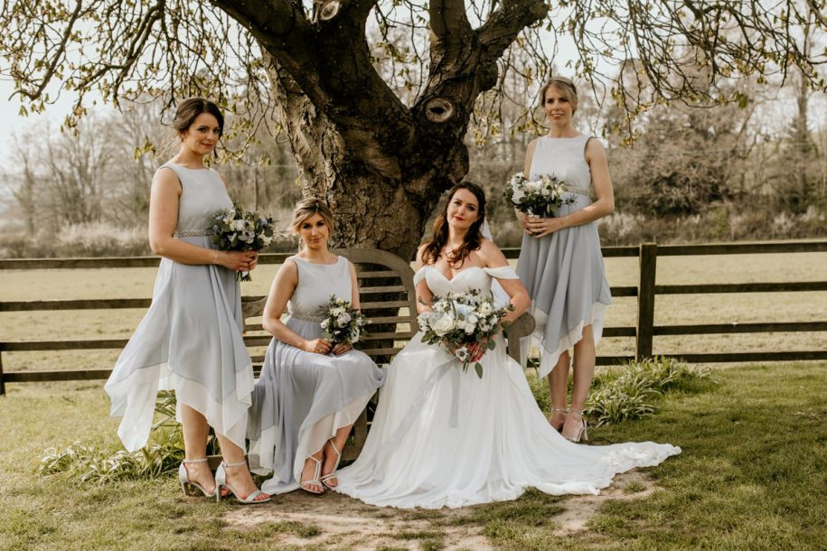 bridesmaids with bride during family group shots at hyde house cotswolds