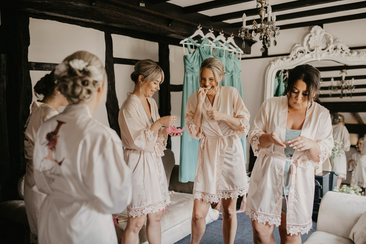 bridesmaids in robes with their wedding gift