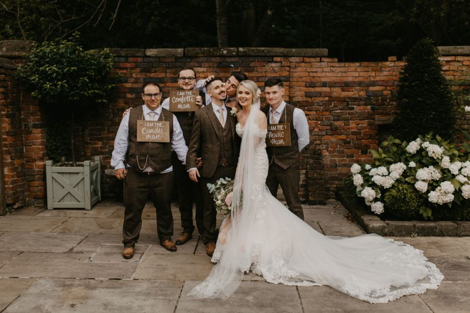 groomsmen with bride and groom during the wedding at Shustoke Barn