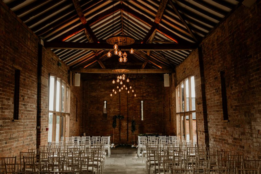 wedding ceremony barn area at mickleton hills farm wedding venue