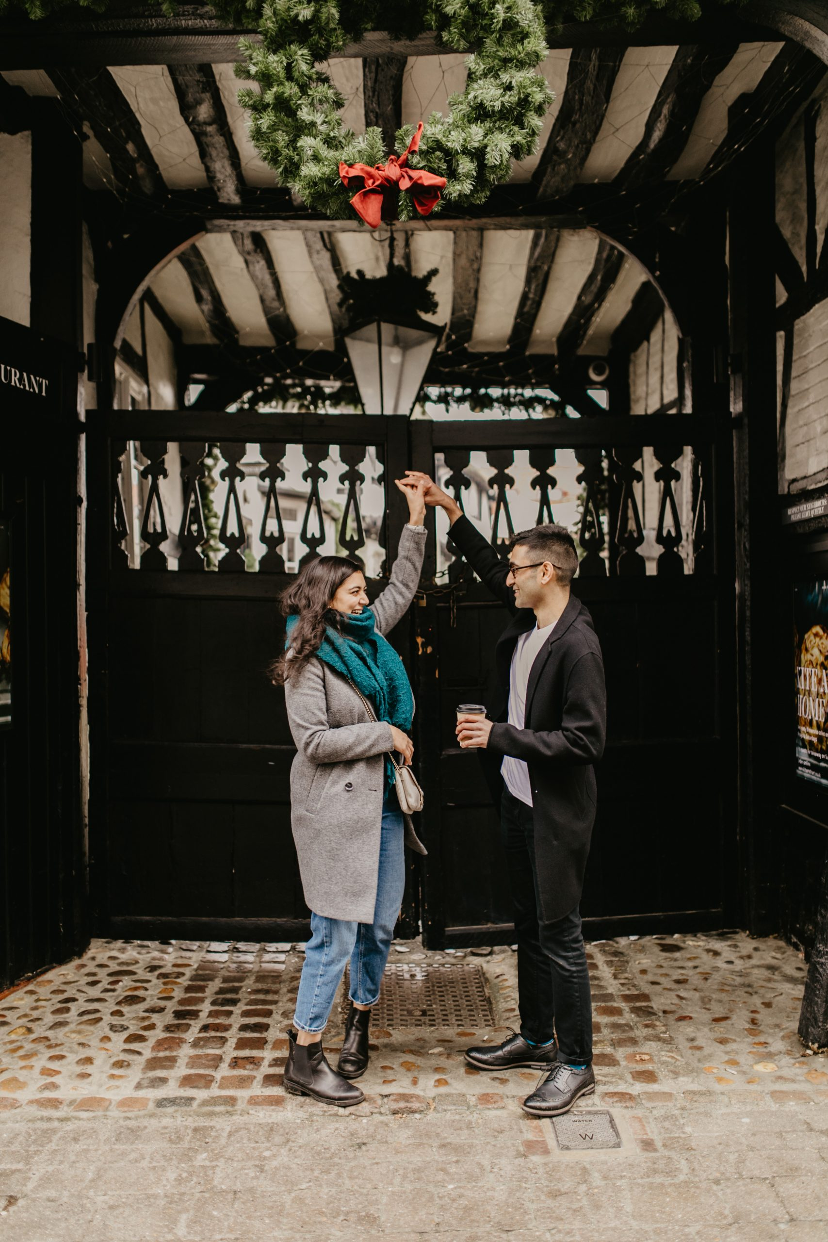 couple under an arch during their proposal session