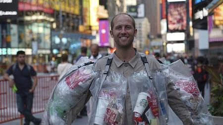 This man wears his garbage to raise awareness concerning waste