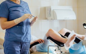 emale doctor gynecologist preparing to give pap smear