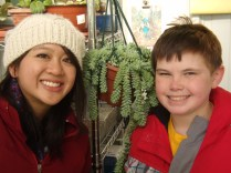 Back in the safety of the greenhouse, Jordan removes his disguise for a snapshot with Ms. Angela