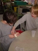 Isaac helps Michael create his sachet.