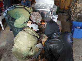 Students learn how to build a strong fire.