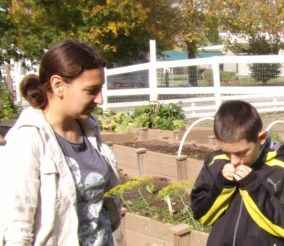 Our intern, Ms. Kerri, offers Skylar a variety of herbs to smell.