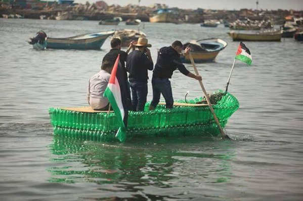 Palestinians make a boat out of empty plastic bottles