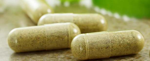 green herbal capsules