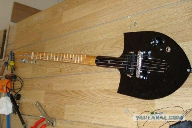 anonymous artist converts shovel into a guitar