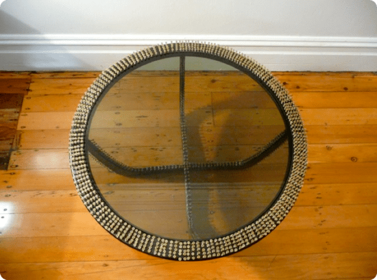 artist revamps wooden side table by using 1500 scr