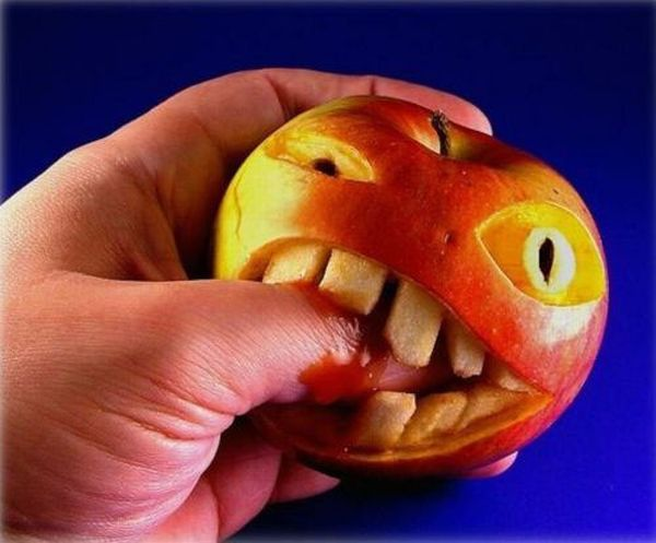 fruit and vegie sculpture apple biting finger1