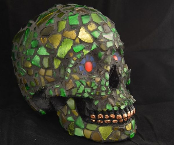 mosaic human skull made with green recycled glass