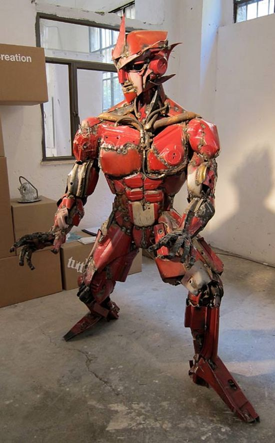 transformer sculpture made from actual auto parts