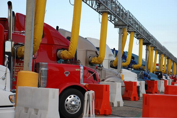 Truck stop electrification and tolling