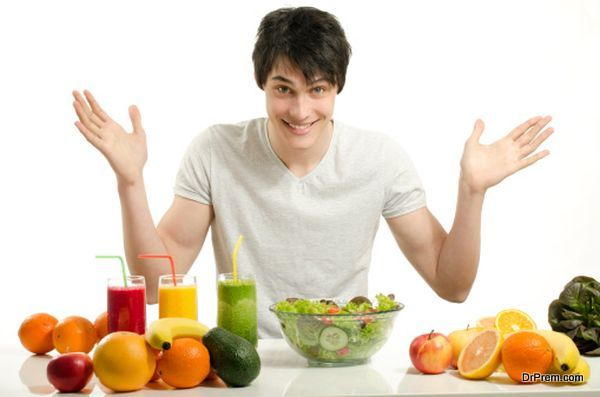 Man having a table full of organic food,juices, smoothie