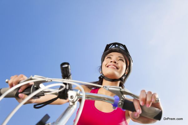 portrait of young biker riding folding bicycle