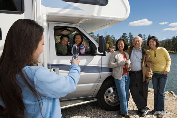 Woman Photographing Her Family with Cell Phone Camera