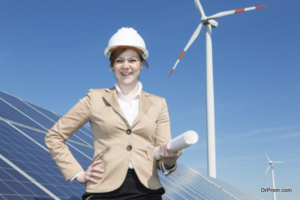 architect or engineer posing at solar panels in wind farm