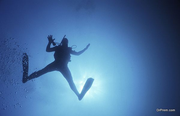 Scuba diver swimming underwater