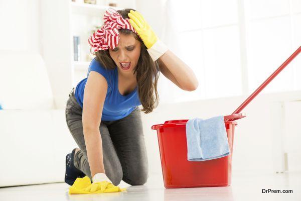Young beautiful woman scrubing floor