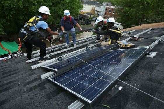 Workers install solar panels.jpg