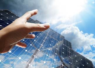hand reaching for solar panels