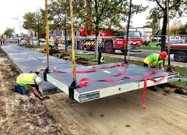 solar powered bike lane being installed in the Netherlands
