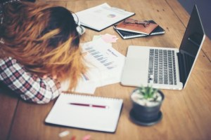 caffeine makes you awake and alert - women sleeping on laptop