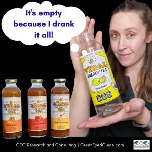 science behind vibal energy tea - greeneyedguide holding drink