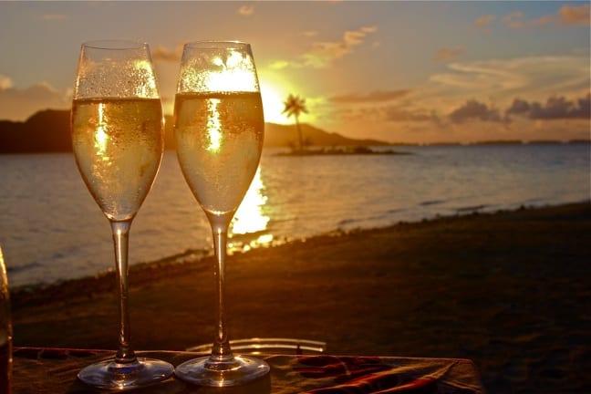 A sunset Champagne toast at the FOur Seasons Resort Bora Bora.
