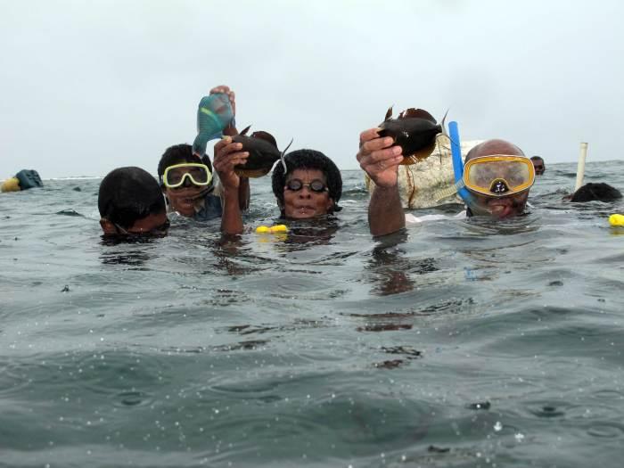 Fiji fishers showing off catch