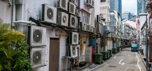 Air Conditioning units crowd the rear wall of a Singapore street.