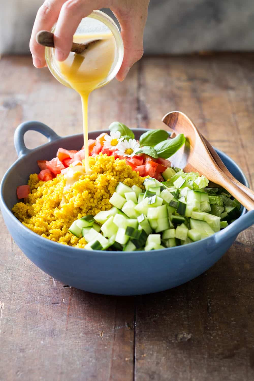 Healthy side dish for any BBQ: Turmeric Quinoa Salad. Fragrant turmeric quinoa, fresh cucumber, romaine lettuce & tomato & delicious honey mustard dressing.