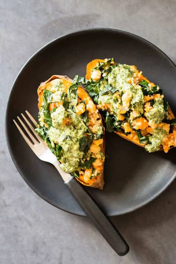 Looking for a 100% healthy stuffed sweet potato recipe? You found it! These vegan Kale Quinoa Stuffed Sweet Potatoes are choked full of nutrition.