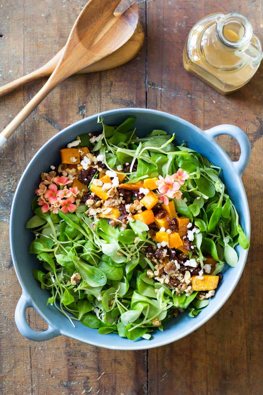 Roasted Butternut Squash Salad, the very best fall salad. Warm butternut squash, dried cranberries, crisp walnuts, soft goat cheese & silky lamb's lettuce.
