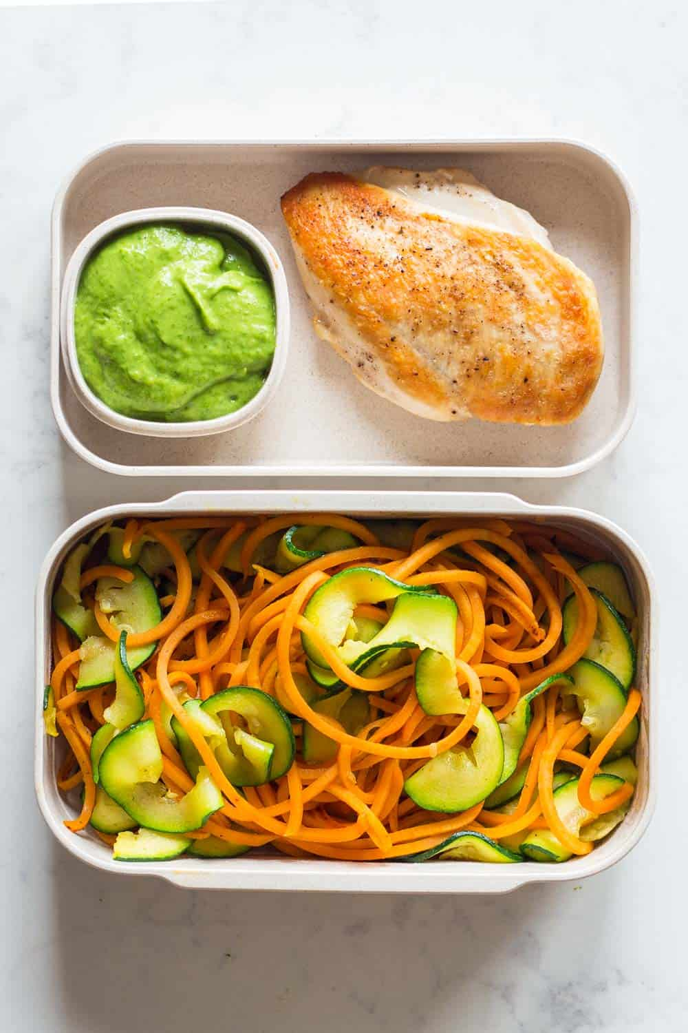 Clean Eating Dinner for a Clean Eating Meal Plan - pan-fried chicken breast, stir-fried spiralized sweet potato and zucchini with an avocado cilantro dressing.