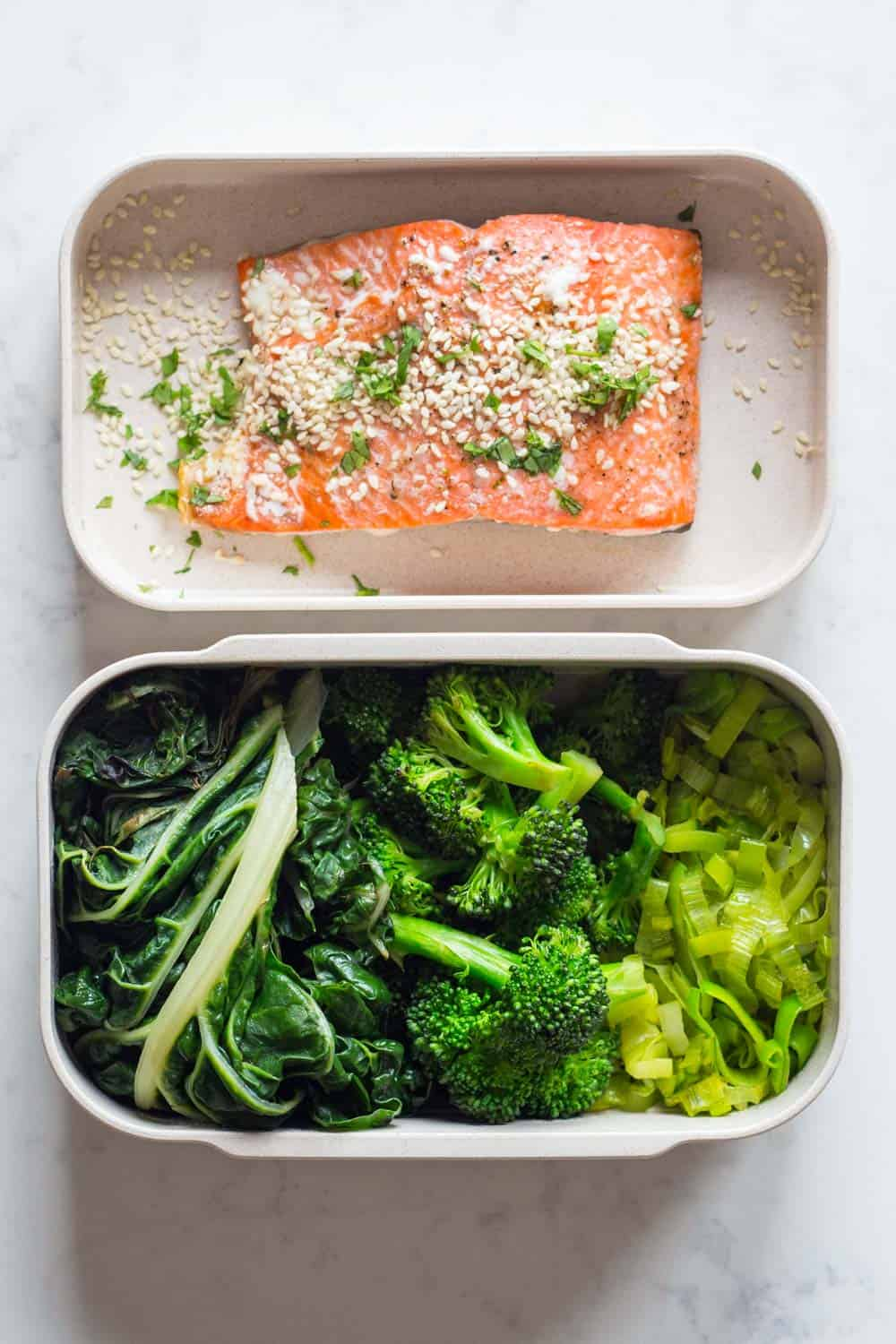 A healthy Paleo dinner for your Paleo Meal Plan - Oven-baked salmon fillet served with sautéed leek, broccoli and swiss chard.