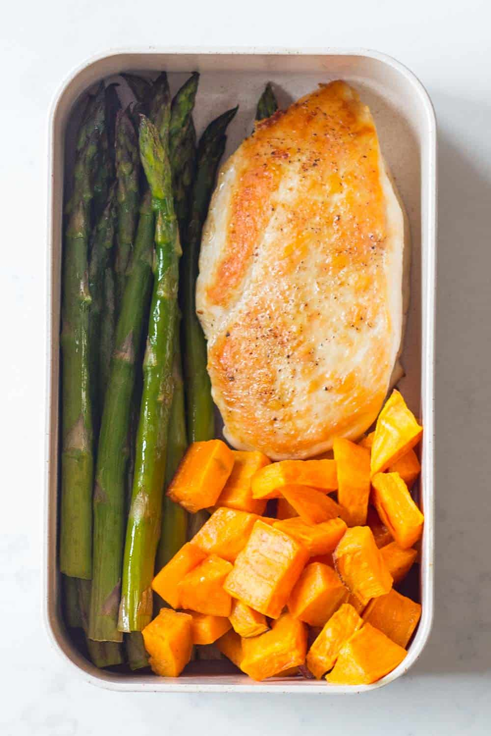 A healthy Paleo Lunch for your Paleo Meal Plan - pan fried chicken breast with roasted sweet potato and asparagus.