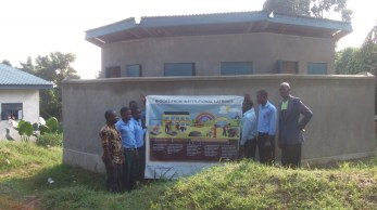 nyahuka students possing infront of the biogas toilet