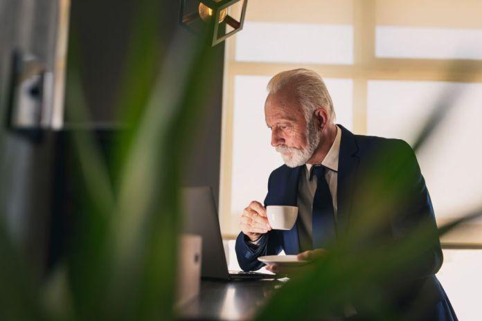 a senior businessman is drinking coffee