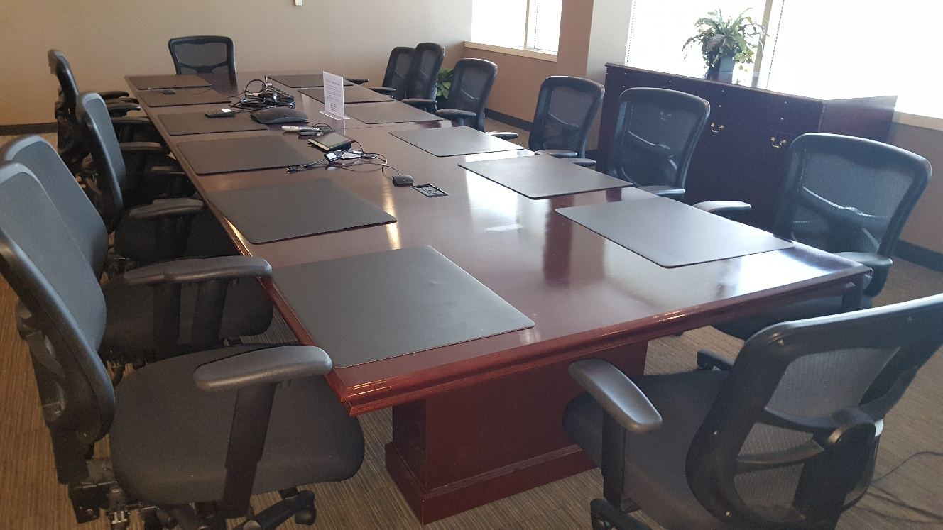 meeting table with chairs ready for removal