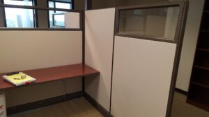 empty office with only cubicles remaining in the process of being broken down and removed