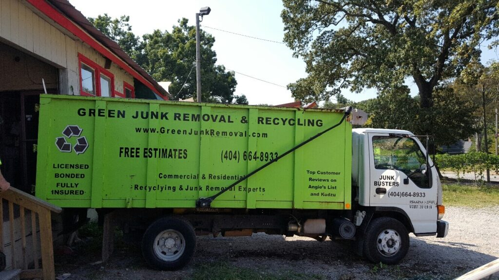 Green Junk Removal truck loads up appliances to recycle