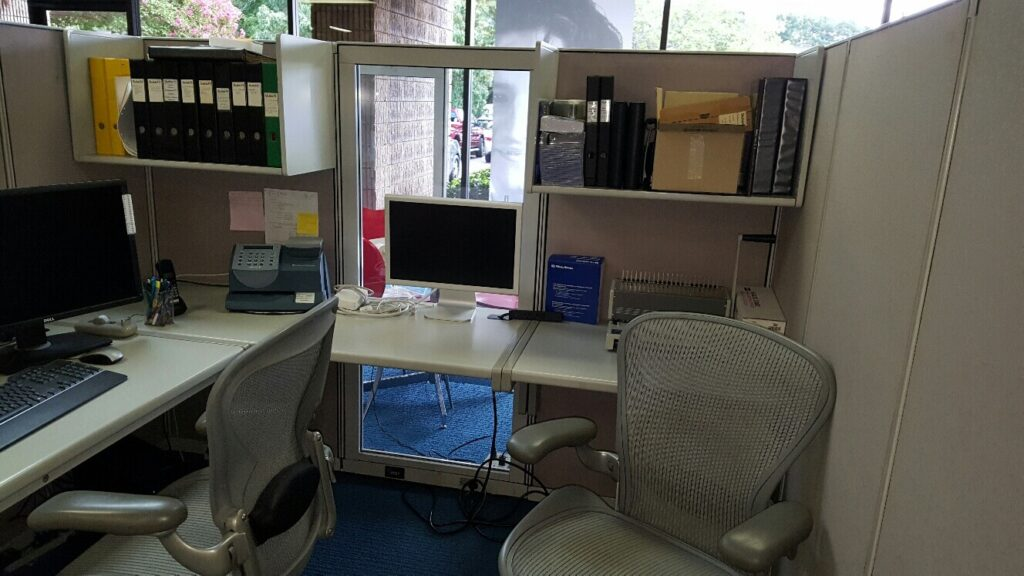Office cubicle, monitors, documents, and junk in Norcross