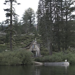 Salmon Lake California,View of the lake shore cabin from a passing canoe